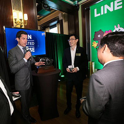 NYSE President Tom Farley speaks with executives from LINE Corporations on the day of their IPO