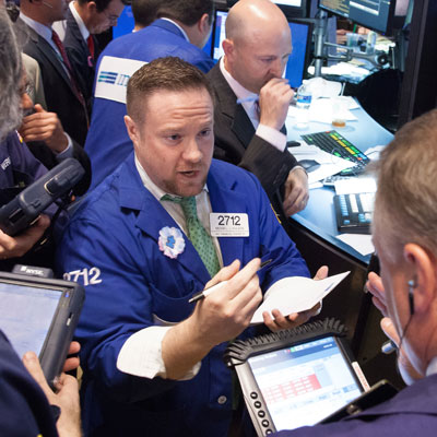 DMM discussing bid and ask price on floor at NYSE